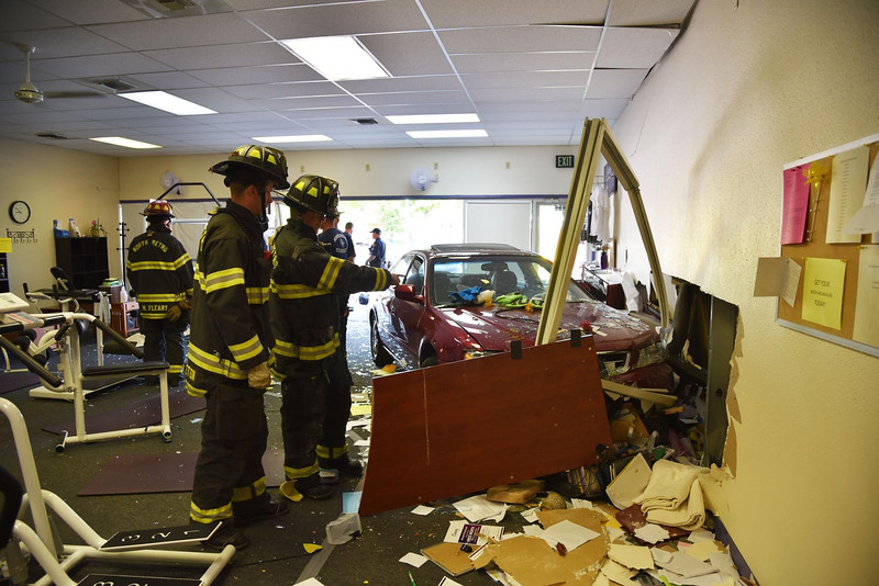 A car crashed into the Curves at Midway and Lowell boulevards in Broomfield around 8:30 a.m. on Tuesday. Courtesy photo/North Metro Fire Rescue District