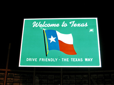 This sign greeted visitors to Texas as they drove across the state line.