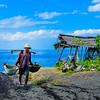 Traditional Sea Salt Maker Carrying Water Buckets