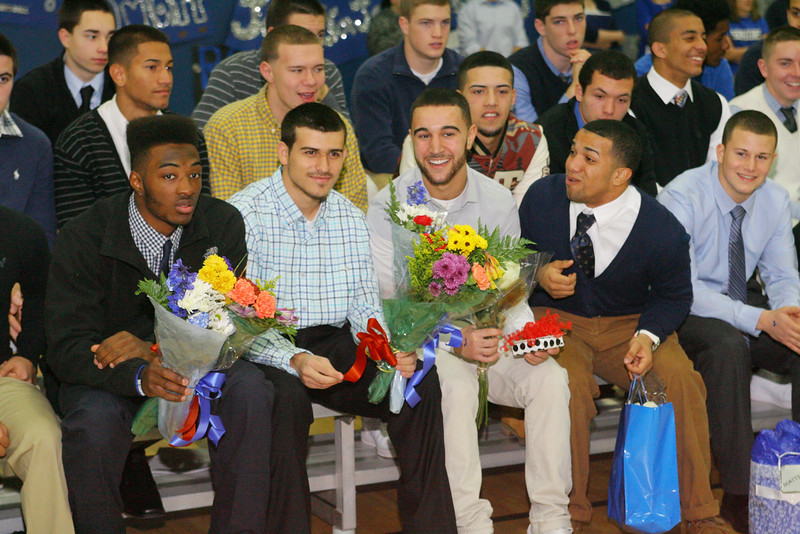 Leominster High School varsity football seniors with flowers during the school's pep rally, Tuesday. <br /> (photo courtesy of Creative by O'Connor Studios)