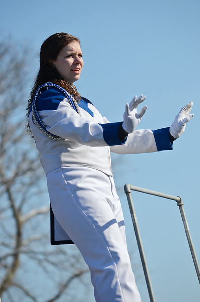 Drum Major Samantha Zick instructs the Blue Devil Marching Band during the Thanksgiving matchup on Saturday afternoon at Doyle Field. SENTINEL & ENTERPRISE / Ashley Green
