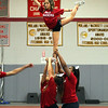 Fitchburg High School cheerleader Mariah Comeau is held up by her fellow teammates during their performance at the pep rally on Wednesday morning at the school. SENTINEL & ENTERPRISE/JOHN LOVE