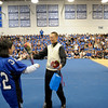SENTINEL & ENTERPRISE / BRETT CRAWFORD<br /> In Hwa Griffith receives flowers from her son, senior football player Kevin Griffith during Leominster High School's pep rally, Tuesday.