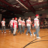 SENTINEL & ENTERPRISE / CONNOR GLEASON<br />  Fitchburg High School's football team enter the gym during the pep rally at FHS Tuesday evening. FHS will face off against Leominster High School during the annual Turkey Bowl at Doyle Field in Leominster Thanksgiving morning.