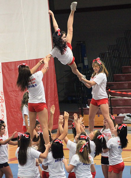 SENTINEL & ENTERPRISE / BYRON SMITH<br /> The Fitchburg High School cheerleading squad perform their stunting routine during the Fitchburg High School pep rally held at Fitchburg High School in Fitchburg on Tuesday, November 25, 2009.