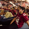 Fitchburg High football players and cheerleaders watch a video during the Thanksgiving pep rally on Wednesday morning. SENTINEL & ENTERPRISE / Ashley Green