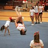 SENTINEL & ENTERPRISE / BYRON SMITH<br /> Fitchburg High School senior Kimberly Bryce, 18,  center, performs a backflip as part of the cheerleading squad's stunting routine during the Fitchburg High School pep rally held at Fitchburg High School in Fitchburg on Tuesday, November 25, 2009.