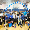 SENTINEL & ENTERPRISE / BRETT CRAWFORD<br /> Senior football player David Fergusson (right) stands to be recognized as the rest of the team applauds during Leominster High School's pep rally, Tuesday.