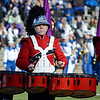 Mia Valadez performs with the Red Raider Marching Band during the Thanksgiving matchup on Saturday afternoon at Doyle Field. SENTINEL & ENTERPRISE / Ashley Green
