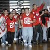SENTINEL & ENTERPRISE / JONATHAN PHILLIPS<br /> The Fitchburg High School football team led by (L) Johnny Gomez, Nick McNamara and Jeremy Kimber breaks through the banner at the beginning of the pep rally at the Doug Grutchfield Field House, Tuesday night.