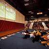 SENTINEL & ENTERPRISE / BRETT CRAWFORD<br /> Fitchburg High School football players and cheerleaders gather up front to watch a game-footage video during the school's pep rally, Tuesday, in preparation for Thursday's Thanksgiving Day rivalry game against Leominster High School.