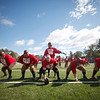 SENTINEL & ENTERPRISE / CONNOR GLEASON<br /> Members of the Fitchburg High School Redskins during warmups before the 1933 recreation game between then-Fitchburg High School Redskins and the then-Leominster Blue and White Warriors at Doyle Field in Leominster Saturday afternoon. The game recreated the historic 1933 Thanksgiving Day game between the two undefeated teams.The Fitchburg Redskins defeated the Leominster Blue and White Warriors, 15-14.