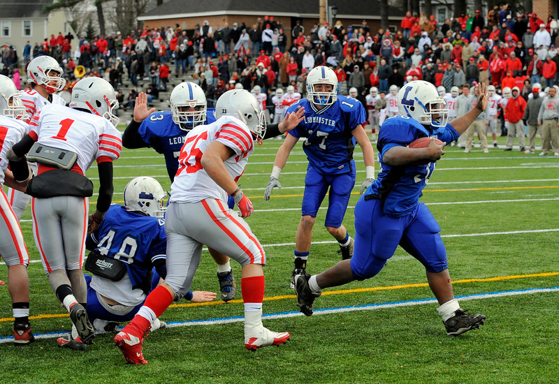 SENTINEL & ENTERPRISE / BRETT CRAWFORD<br /> Leominster's Cortez Ludden runs the ball in for the game-winning touchdown in double overtime during Thursday's Thanksgiving Day game at Doyle Field against Fitchburg.