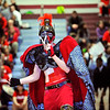 SENTINEL & ENTERPRISE / BRETT CRAWFORD<br /> Senior Merrick Henry, as the Red Raider, performs a song to pump up the students during Fitchburg High School's pep rally, Tuesday, in preparation for Thursday's Thanksgiving Day rivalry game against Leominster High School.