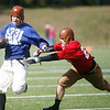SENTINEL & ENTERPRISE / CONNOR GLEASON<br /> The Leominster Blue and White Warriors' Nate Comeau breaks through the defense of Fitchburg High School Redskins' Curtis Stillman during the 1933 recreation game between then-Fitchburg High School Redskins and the then-Leominster Blue and White Warriors at Doyle Field in Leominster Saturday afternoon. The game recreated the historic 1933 Thanksgiving Day game between the two undefeated teams.The Fitchburg Redskins defeated the Leominster Blue and White Warriors, 15-14.