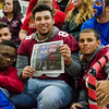 Seniors Jordan Hughes, Facundo Isas and Marley Keating show off a copy of the Sentinel & Enterprise's 'Football Rivalry' special section during the Thanksgiving pep rally on Wednesday morning. SENTINEL & ENTERPRISE / Ashley Green