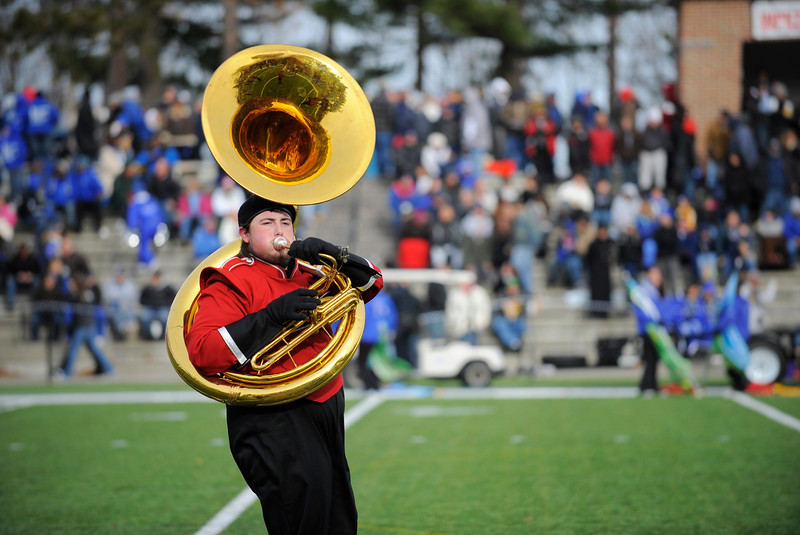 SENTINEL & ENTERPRISE / BRETT CRAWFORD<br /> Fitchburg High School student Alton Modlin plays the tuba during half time of the Thanksgiving Day game of Fitchburg High School against Leominster High School, Thursday at Doyle Field.