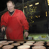 SENTINEL & ENTERPRISE / JONATHAN PHILLIPS<br /> Fitchburg High School Senior Class Advisor Mark Pierce cooks hamburgers over the grill in front of the school, Tuesday night, during the tailgate party and pep rally.
