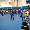 SENTINEL & ENTERPRISE / BRETT CRAWFORD<br /> Leominster High School senior cheerleader Brittany Gauvin, 17, performs a cheer as the senior football players' mothers perform a cheer during the school's pep rally, Tuesday.