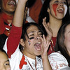 SENTINEL & ENTERPRISE / JONATHAN PHILLIPS<br /> Fitchburg High School senior Naomi Mora, 17, cheers with the crowd during the pre Thanksgiving pep rally at the Doug Grutchfield Field House, Tuesday night.