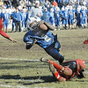 SENTINEL & ENTERPRISE / BRETT CRAWFORD<br /> Leominster's Curtis Ludden dives over Fitchburg's Tim McNamara for a two-point conversion during the Thanksgiving Day game at Doyle Field, Thursday.