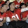 SENTINEL & ENTERPRISE / JONATHAN PHILLIPS<br /> Fitchburg High School football players (L) Jeremy Kimber and Johnny Gomez watch a film with the rest of the team during the pre Thanksgiving pep rally at the Doug Grutchfield Field House, Tuesday night.
