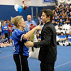 SENTINEL & ENTERPRISE / BRETT CRAWFORD<br /> Karen Mahoney receives flowers and a hug by her son, senior football player Tim Lanza during Leominster High School's pep rally, Tuesday.