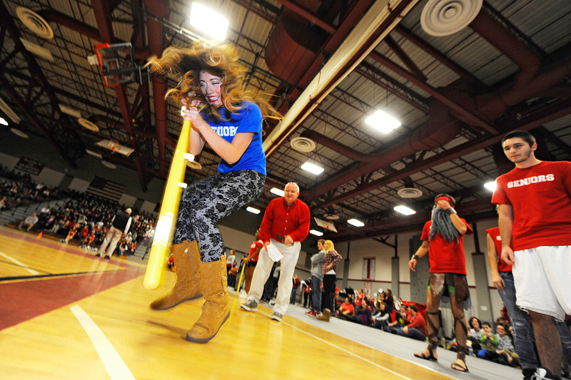 Senior Ailynn Tiernan, class secretary, participates in a class officers spin-the-bat relay during Fitchburg High School's pep rally, Wednesday morning.<br /> SENTINEL & ENTERPRISE / BRETT CRAWFORD