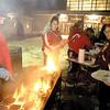 SENTINEL & ENTERPRISE / JONATHAN PHILLIPS<br /> (L) Bryan Baxter cooks hamburgers over the grill in front of Fitchburg High School, Tuesday night, during the tailgate party and pep rally.