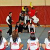 SENTINEL & ENTERPRISE / BRETT CRAWFORD<br /> Fitchburg High School football players perform a cheer in front of the senior cheerleaders during the school's pep rally, Tuesday, in preparation for Thursday's Thanksgiving Day rivalry game against Leominster High School.