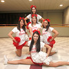 SENTINEL & ENTERPRISE / CONNOR GLEASON<br /> Back row, left to right, Fitchburg High School senior cheerleaders Christina Kosmidis, 17, Nicole Benoit, 18,  Kelsi Whittemore, 17, and Erica Chambers, 18, gather during FHS's pep rally at FHS Tuesday evening. FHS will face off against Leominster High School during the annual Turkey Bowl at Doyle Field in Leominster Thanksgiving morning.