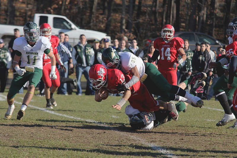 SENTINEL & ENTERPRISE / JOHN LOVE<br /> Nashoba's #25 Eli Williams takes down NMRHS Brandon Lambert from behind during action in the Thanksgiving Day game in Townsend Thursday morning.