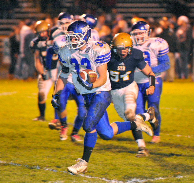 NASHOBA PUBLISHING / BRETT CRAWFORD<br /> Lunenburg's Cody Jacobs runs for a touchdown during Wednesday night's Thanksgiving Eve game against St. Bernard's at the Bernardian Bowl in Fitchburg. Lunenburg won 36-8.