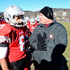Fitchburg Head Coach Dan Walker talks with Darius Flowers on the sideline during Thursday's Thanksgiving Day rivalry game against Leominster at Crocker Field.<br /> SENTINEL & ENTERPRISE / BRETT CRAWFORD