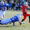Fitchburg's Nik Myles avoids the tackle of Leominster's James Gurley during Thursday's Thanksgiving Day rivalry game.<br /> SENTINEL & ENTERPRISE / BRETT CRAWFORD