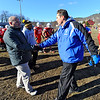 Fitchburg Head Coach Dan Walker (left) shakes hands with Leominster Head Coach Dave Palazzi at the conclusion of Thursday's Thanksgiving Day rivalry game against Leominster at Crocker Field.<br /> SENTINEL & ENTERPRISE / BRETT CRAWFORD