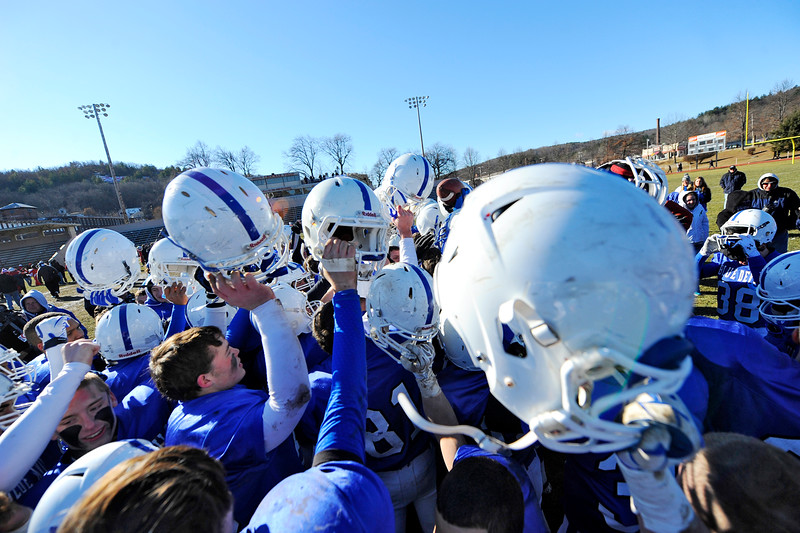 Leominster celebrates their 49-28 win over Fitchburg at the conclusion of Thursday's Thanksgiving Day rivalry game at Crocker Field.<br /> SENTINEL & ENTERPRISE / BRETT CRAWFORD