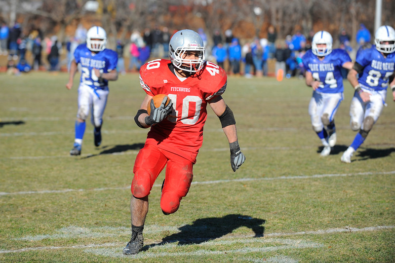 Fitchburg's Marcos Diaz runs for extra yards after receiving a pass during Thursday's Thanksgiving Day rivalry game against Leominster at Crocker Field.<br /> SENTINEL & ENTERPRISE / BRETT CRAWFORD
