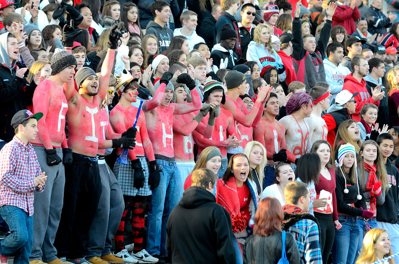 SENTINEL & ENTERPRISE / BRETT CRAWFORD<br /> Fitchburg High School students with paint on their stomachs cheer during Thursday's annual Thanksgiving Day rivalry football game against Leominster at Doyle Field. Leominster won 38-22.
