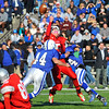 SENTINEL & ENTERPRISE / BRETT CRAWFORD<br /> Fitchburg quarterback Connor Lemieux gets hit by Leominster's Matthew Banchs (left) and Lamech Muma (right) during Thursday's annual Thanksgiving Day rivalry football game at Doyle Field. Leominster won 38-22.