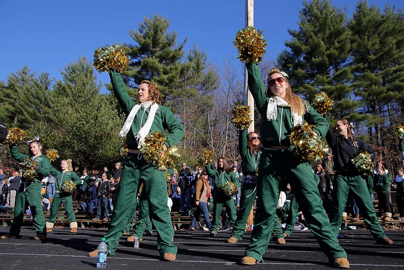SENTINEL & ENTERPRISE / JOHN LOVE<br /> Nashoba Cheerleading captains Shannon Perking and Casey Ondrus lead their girls in a cheer during the fourth quarter of the game.