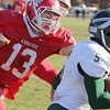 SENTINEL & ENTERPRISE / JOHN LOVE<br /> Nashoba's John Ojukwu  tries to get by NNMRHS's Brandon Lambert druing action in the Thanksgiving game on Thursday morning.