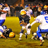 NASHOBA PUBLISHING / BRETT CRAWFORD<br /> St. Bernard's Colby Georges runs with the ball as Lunenburg's Jeremy Nash lines up for the tackle during Wednesday night's Thanksgiving Eve game at the Bernardian Bowl in Fitchburg. Lunenburg won 36-8.