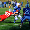 SENTINEL & ENTERPRISE / BRETT CRAWFORD<br /> Leominster's James Gurley runs with the ball as Fitchburg's Marcos Diaz wraps up for the tackle during Thursday's annual Thanksgiving Day rivalry football game at Doyle Field. Leominster won 38-22.