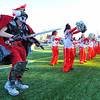 SENTINEL & ENTERPRISE / BRETT CRAWFORD<br /> Fitchburg High School senior Merrick Henry as the FHS Red Raider, dances with the cheerleaders during Thursday's annual Thanksgiving Day rivalry football game at Doyle Field. Leominster won 38-22.