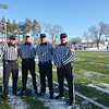 Officials pose before the Thanksgiving classic on Saturday afternoon at Doyle Field. From left is Todd Deacon, Dave Douglas, Bill Gosselin, Frank Marabello and Dave Napalotano. SENTINEL & ENTERPRISE / Ashley Green