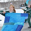 Tsara Walsh, 16, and the Oakmont Color Guard perform along with the Marching Band during the Thanksgiving game against Gardner on Thursday morning. SENTINEL & ENTERPRISE / Ashley Green