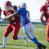 Leominster's Keith Jackson brings down Fitchburg's Alex Marrero during the Thanksgiving matchup on Saturday afternoon at Doyle Field. SENTINEL & ENTERPRISE / Ashley Green