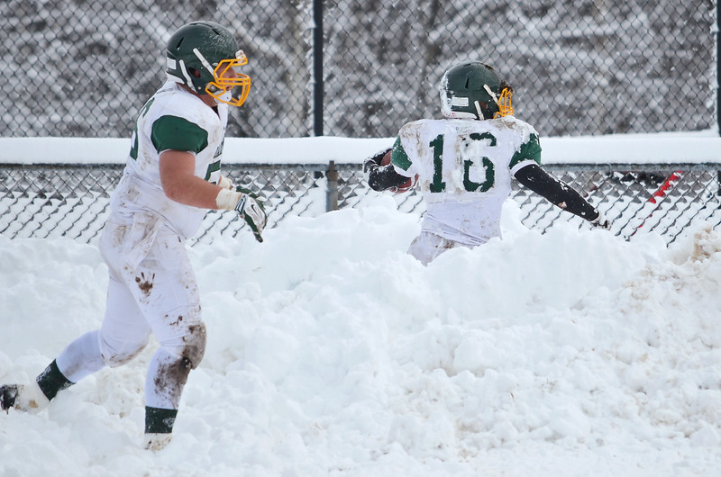 Oakmont's Tyler Caforio falls out of bounds and into a snow bank during the Thanksgiving game against Gardner on Thursday morning. SENTINEL & ENTERPRISE / Ashley Green