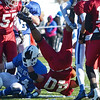 Fitchburg's Marcos Diaz is brought down by the LHS defense during the Thanksgiving matchup between Leominster and Fitchburg on Saturday afternoon at Doyle Field. SENTINEL & ENTERPRISE / Ashley Green